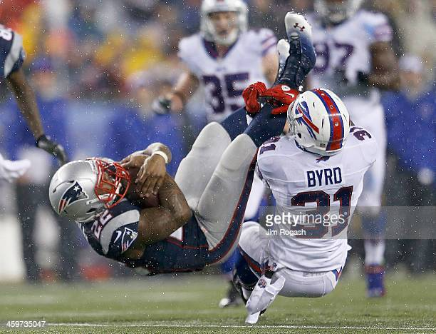 Stevan Ridley of the New England Patriots is tackled by Jairus Byrd of the Buffalo Bills in the 1st quarter at Gillette Stadium on December 29, 2013...