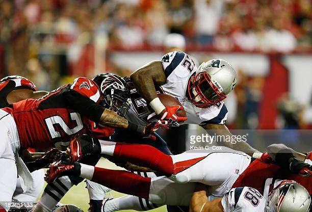 Stevan Ridley of the New England Patriots is tackled by Thomas DeCoud of the Atlanta Falcons during the game at Georgia Dome on September 29 2013 in...