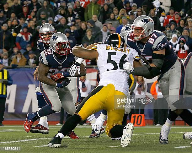 Stevan Ridley of the New England Patriots works his way by LaMarr Woodley of the Pittsburgh Steelers for a touchdown in the 2nd quarter during a game...