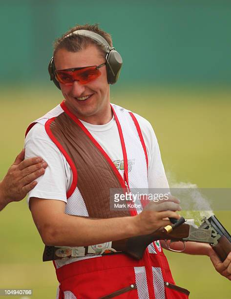 Stevan Walton of England poses celebrates winning the gold medal in the men's double trap at the Dr Karni Singh Shooting Range during day four of the...