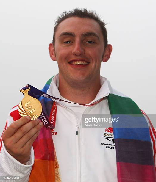 Stevan Walton of England poses with his gold medal won in the men's double trap at the Dr Karni Singh Shooting Range during day four of the Delhi...