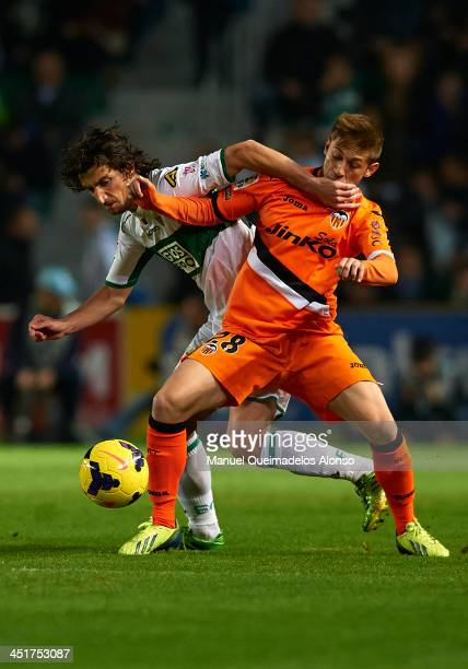 Stevanovic of Elche competes for the ball with Fede of Valencia during the La Liga match between Elche FC and Valencia CF at Manuel Martinez Valero...