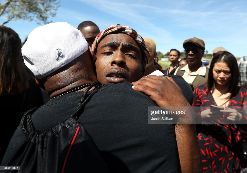 Stevante Clark, whose brother Stephon was shot and killed by Sacramento police, hugs a mourner outside of the funeral services for Stephon at the Bayside Boss Church on March 29, 2018 in Sacramento, California. Funeral services were held for Stephon Clark who was shot and killed by Sacramento police who thought he was carrying a gun over a week ago. Clark was found to only have a cell phone.