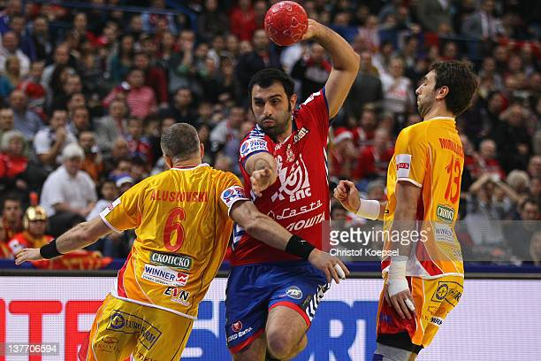 Stevche Alushovski of Macedonia and Filip Mirkulovski of Macedonia defend against Ivan Stankovic of Serbia during the Men's European Handball...