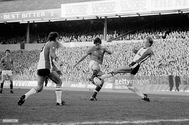Steve Aizlewood of Portsmouth has his shot blocked by Mark Wright of Southampton during the Portsmouth v Southampton FA Cup 4th Round match played at...