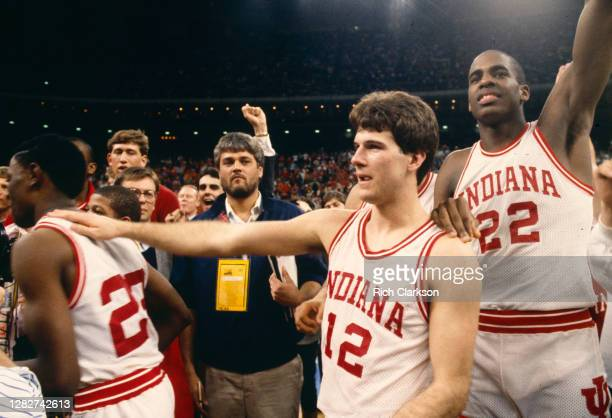 Steve Alford and Dean Garrett of the Indiana Hoosiers celebrate their victory against the Syracuse Orangemen during the NCAA Men's Basketball...