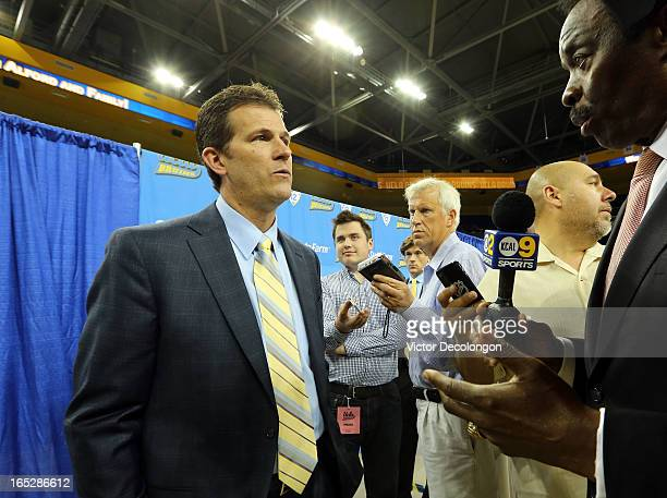 Steve Alford answers questions from local sports anchor Jim Hill at a press conference after being introduced as UCLA's new head men's basketball...