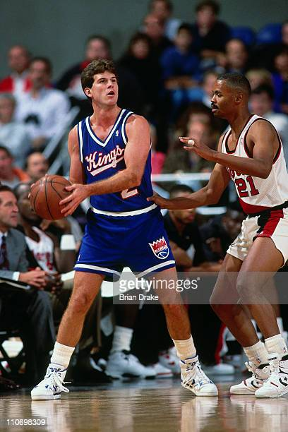 Steve Alford of the Sacramento Kings drives against the Portland Trailblazers during a game played at Memorial Coliseum in Portland Oregon circa 1991...