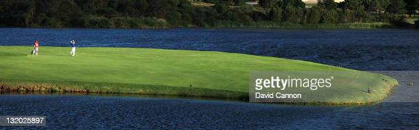 Steve Alker of New Zealand plays his third shot at the 17th hole during day one of the 2011 Emirates Australian Open at The Lakes Golf Club at The...