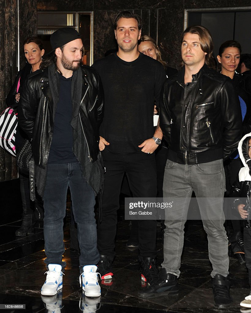 Steve Angello, Sebastian Ingrosso and Axwell of the Swedish House Mafia light The Empire State Building on February 28, 2013 in New York City.