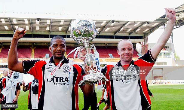 Steve Anthrobus and Chris Brindley of Hendnesford Town celebrate their victory during the FA Trophy Final match between Canvey Island and Hednesford...