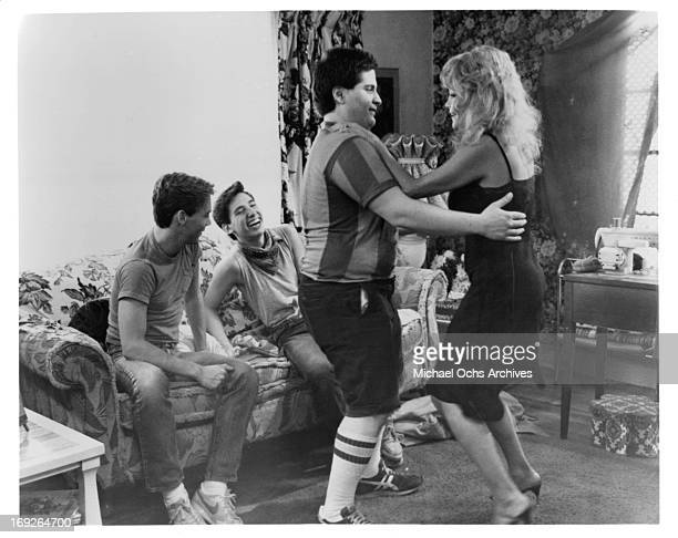 Steve Antin and Lawrence Monoson sharing a laugh as Joe Rubbo dances with Louisa Moritz in a scene from the film 'The Last American Virgin', 1982.