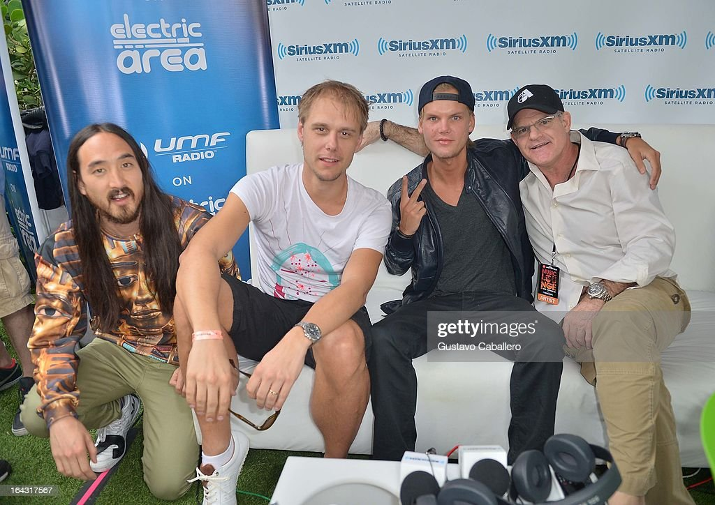 Steve Aoki, Armin van Buuren, Scott Greenstein, President and Chief Content Officer, SiriusXM, and AVICII visit the SiriusXM Music Lounge at W Hotel on March 22, 2013 in Miami, Florida.