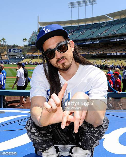 Steve Aoki performs before a baseball game between the Colorado Rockies and the Los Angeles Dodgers at Dodger Stadium on April 19 2015 in Los Angeles...
