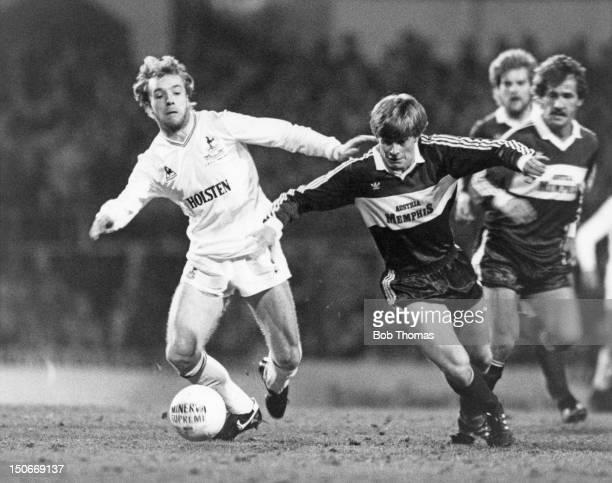 Steve Archibald of Tottenham Hotspur competes for the ball with defender Josef Degeorgi of FK Austria Memphis Magna during the the UEFA Cup quarter...