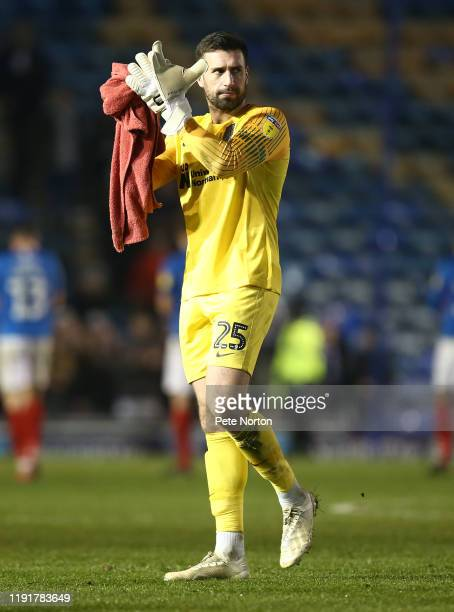 Steve Arnold of Northampton Town applauds the Northampton Town fans as he leaves the pitch at the end of the Leasingcom Trophy match between...
