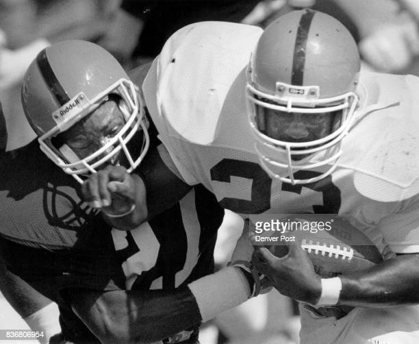 Steve Atwater and Sammy Winder bang heads during a short scrimmage at Broncos camp in Greeley Credit The Denver Post