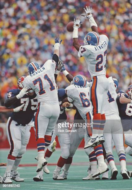Steve Atwater Full Safety and Greg Kragen Nose Tackle for the Denver Broncos jump to block a play against the Buffalo Bills during their American...