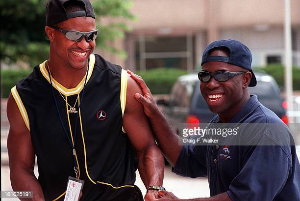 Steve Atwater jokes with Broncos media staff member Richard Stewart after checking into the Denver Broncos training camp at the University of...