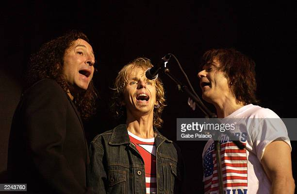 Steve Augeri of Journey Tommy Shaw and Lawrence Gowen of Styx performing at the Volunteers for America rock benefit concert at the HiFi Buys...