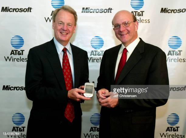 Steve Ballmer CEO of Microsoft and John Zeglis CEO of ATT Wireless announce an agreement July 31 2002 in New York to deliver wireless data and...