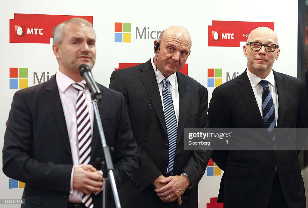 Steve Ballmer, chief executive officer of Microsoft Corp., center, and Andrey Dubovskov, chief executive officer of OAO Mobile TeleSystems, right, listen as Nikolai Pryanishnikov, president for Microsoft Corp. in Russia, speaks during the opening of a new Mobile TeleSystems (MTS) store in Moscow, Russia, on Tuesday, Nov. 6, 2012. OAO Mobile TeleSystems will extend cooperation with Microsoft Corp. and plans to sell Windows devices in its 5,000 Russian stores. Photographer: Alexander Zemlianichenko Jr./Bloomberg via Getty Images