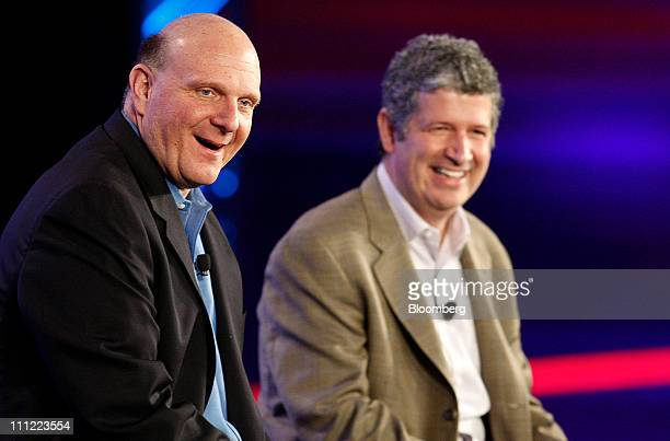 Steve Ballmer chief executive officer of Microsoft Corp left and Darren Huston vice president of global consumer and online for Microsoft Corp smile...