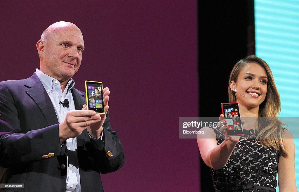 Steve Ballmer, chief executive officer of Microsoft Corp., left, and actress Jessica Alba speak at an event to unveil Windows Phone 8 software in San Francisco, California, U.S., on Monday, Oct. 29, 2012. Microsoft Corp. unveiled a new version of its software for smartphones today, redoubling an effort to regain market share lost to Apple Inc. and Google Inc. Photographer: Tony Avelar/Bloomberg via Getty Images