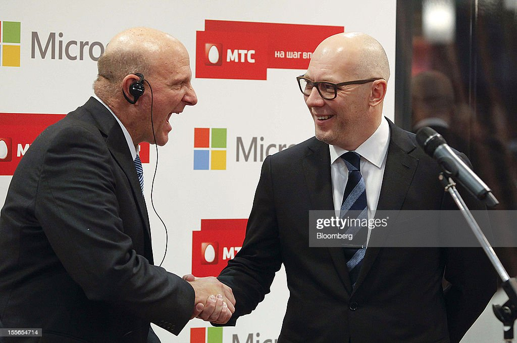 Steve Ballmer, chief executive officer of Microsoft Corp., left, shakes hands with Andrey Dubovskov, chief executive officer of OAO Mobile TeleSystems during the opening of a new Mobile TeleSystems (MTS) store in Moscow, Russia, on Tuesday, Nov. 6, 2012. OAO Mobile TeleSystems will extend cooperation with Microsoft Corp. and plans to sell Windows devices in its 5,000 Russian stores. Photographer: Alexander Zemlianichenko Jr./Bloomberg via Getty Images
