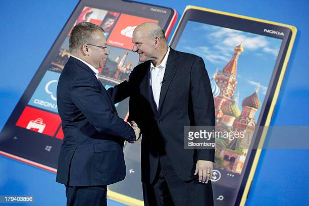 Steve Ballmer chief executive officer of Microsoft Corp right and Stephen Elop chief executive officer of Nokia Oyj shake hands after a presentation...