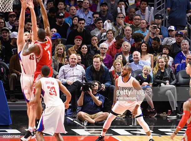 Steve Ballmer Conan O'Brien Neve O'Brien Beckett O'Brien and Liza Powel attend a basketball game between the Houston Rockets and the Los Angeles...
