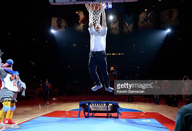 Steve Ballmer owner Los Angeles Clippers dunks a basketball after introducing the team mascot a California Condor named Chuck during the basketball...