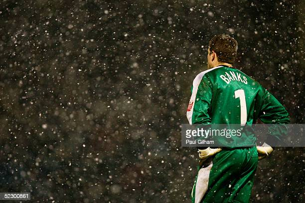 Steve Banks of Gillingham stands in the snow during the CocaCola Championship match between Gillingham and West Ham United at the Priestfield Stadium...