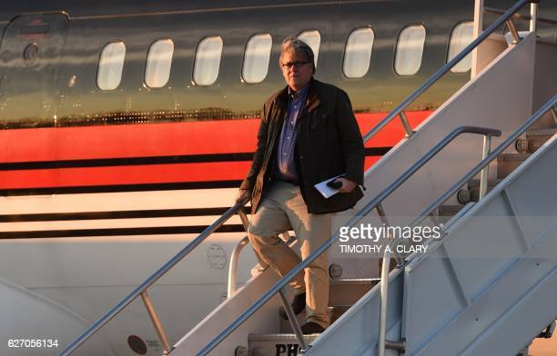Steve Bannon gets off the plane with US Presidentelect Donald Trump arrives at Cincinnati/Northern Kentucky International Airport in Hebron Kentucky...