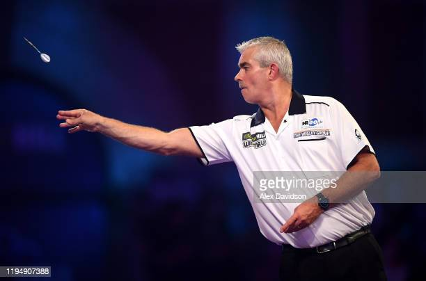 Steve Beaton in action during the round 2 match between Kyle Anderson and Steve Beaton on Day 7 of the 2020 William Hill World Darts Championship at...
