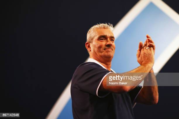 Steve Beaton of England applauds the crowd prior to his match against Vincent Van Der Voort of the Netherlands on day nine of the 2018 William Hill...