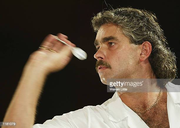 Steve Beaton of England during his match against Cliff Lazarenko of England in the first round of the PDC Stan James World Matchplay Darts...