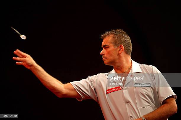 Steve Beaton of England in action against Carlos Rodriguez of Spain during the 2010 Ladbrokescom World Darts Championship Round One at Alexandra...