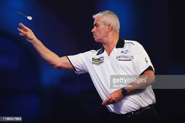 Steve Beaton of England in action against Darius Labanauskas of Lithuania in his Fourth Round match during Day Thirteen of the 2020 William Hill...