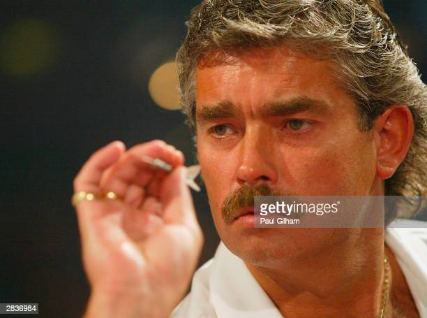 Steve Beaton of England in action against Jamie Harvey of Scotland during the third round of the 2004 Ladbrokescom World Darts Championship at Circus...