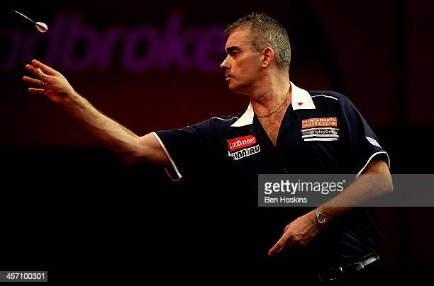 Steve Beaton of England in action during his first round match again Devon Petersen of South Africa day four of the 2014 Ladbrokescom World Darts...