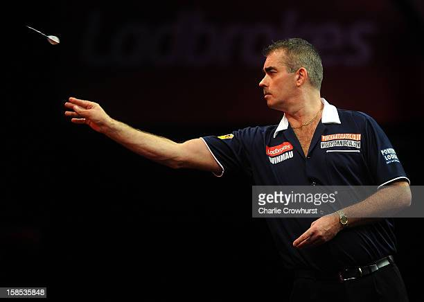 Steve Beaton of England in action during his first round match against Kyle Anderson of Australia on day five of the Ladbrokescom World Darts...