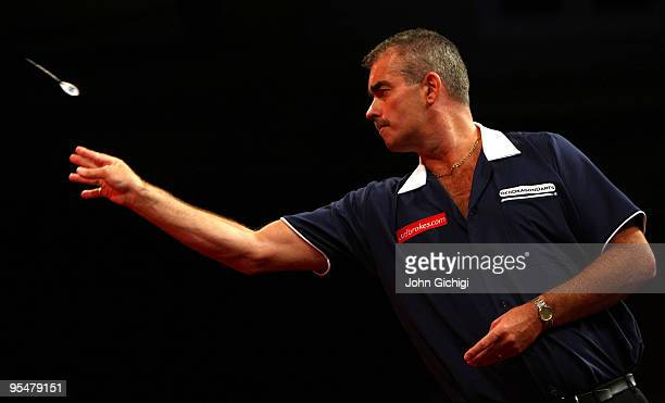 Steve Beaton of England in action during his match against Andy Hamilton of England in the 2010 Ladbrokescom World Darts Championship at Alexandra...