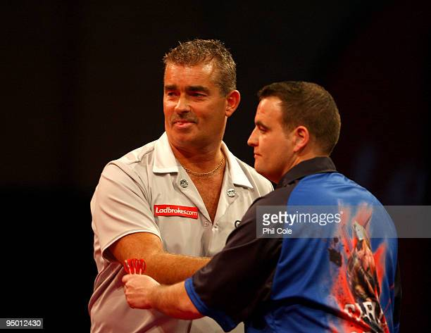 Steve Beaton of England in wins against Carlos Rodriguez of Spain during the 2010 Ladbrokescom World Darts Championship Round One at Alexandra Palace...