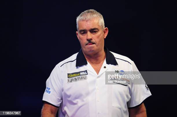 Steve Beaton of England reacts as he walks off the stage for a break between sets in his Fourth Round match against Darius Labanauskas of Lithuania...