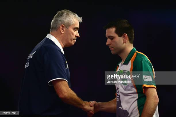 Steve Beaton of England shakes hands with William O'Connor of Ireland after victory in their first round match on day one of the 2018 William Hill...