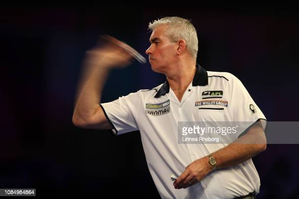 Steve Beaton of England throws in his second round match against Chris Dobey of England during Day Eight of the 2019 William Hill World Darts...