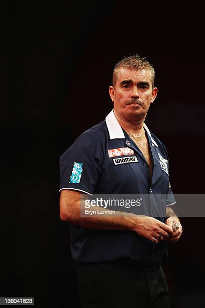 Steve Beaton of Great Britain looks on during his first round match against Magnus Caris of Sweden on day three of the 2012 Ladbrokescom World Darts...