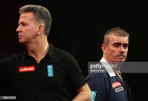 Steve Beaton of Great Britain reacts during his first round match against Magnus Caris of Sweden on day three of the 2012 Ladbrokescom World Darts...