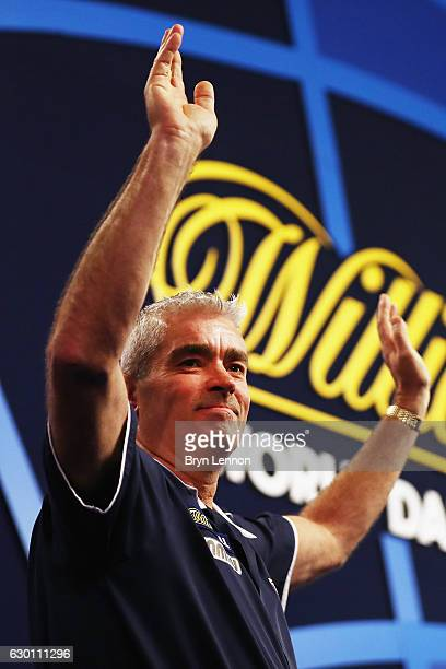 Steve Beaton of Great Britain reacts to the crowd during day two of the 2017 William Hill PDC World Darts Championships at Alexandra Palace on...